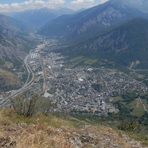 Saint-Jean-de-Maurienne viewed from Croix de Chevrotière on cliff 900m above